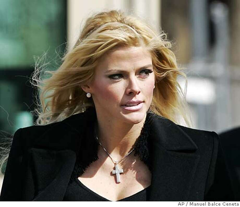**FILE**Anna Nicole Smith, leaves the U.S. Supreme Court after he bid to collect millions of dollars from the estate of J. Howard Marshall II was presented on Feb. 28, 2006, in Washington. The court ruled Monday, May 1, 2006, that the one-time stripper and Playboy Playmate could pursue part of her late husband's oil fortune.(AP Photo/Manuel Balce Ceneta)  Ran on: 05-02-2006  Anna Nicole Smith says her late husband planned to give her half his oil money.  Ran on: 05-02-2006  Anna Nicole Smith says her late husband planned to give her half his oil money.  Ran on: 02-23-2007  Judge Larry Seidlin awards custody of Anna Nicole Smith's body to Richard Millstein, who is representing her baby daughter, Dannielynn.  Ran on: 02-23-2007  Judge Larry Seidlin awards custody of Anna Nicole Smith's body to Richard Millstein, who is representing her baby daughter, Dannielynn. A FEB 28 2006 FILE PHOTO Photo: MANUEL BALCE CENETA