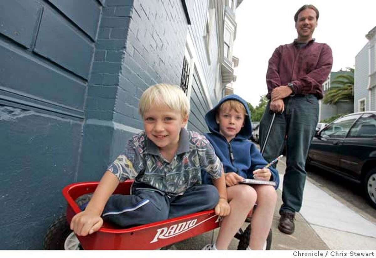 Event on 7/26/05 in San Francisco. This is Richard Register pulls his sons, Arthur, 7, and Warren, 5 (as of 8/28) in a wagon near their Cole Valley home. The boys attend Star of the Sea, a Catholic school in the Richmond. A back-to-school story looking at how three families in Cole Valley made their decisions on where to send their children to school. They're all similar families, but one chose a $19,000 a year all-girls private school, one chose a Catholic school (though they're not Catholic) and one chose the public school down the block. Story looks at the ramifications for neighborhoods when children are going off to school all over the city and what it means for the school district, which is losing hundreds of students each year. Chris Stewart / The Chronicle