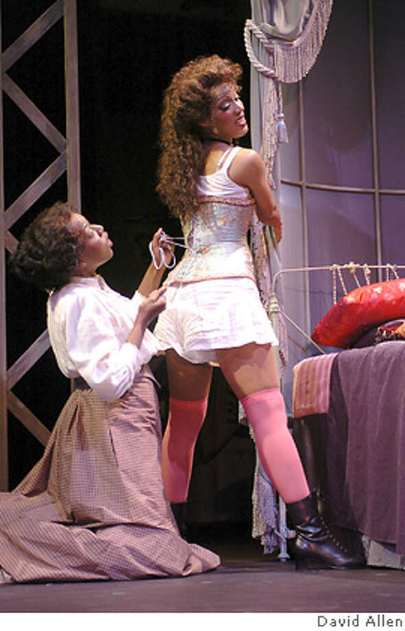 APPAREL29 Esther (l. Laiona Michelle) tightens Mayme's (r. Tracey Conyer Lee) corset Photo credit David Allen