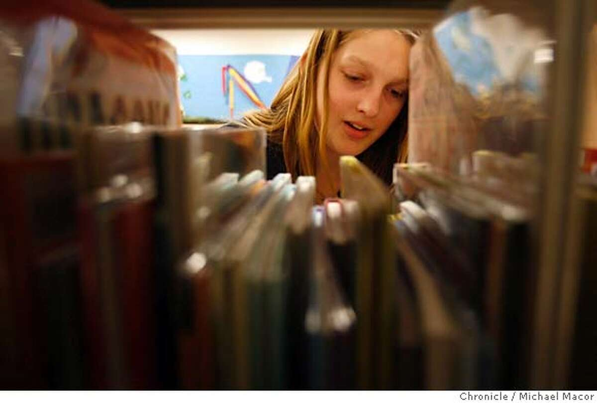 13 year old Miranda Canfield volunteers at the Central Point Library where she cleans up as well as organizes magazines. Jackson County in Southern Oregon, just across the Northern California border is going to close all 15 branch libraries on April 6 due to federal budget cuts. Photographed in, Medford, Or, on 2/23/07. Photo by: Michael Macor/ San Francisco Chronicle