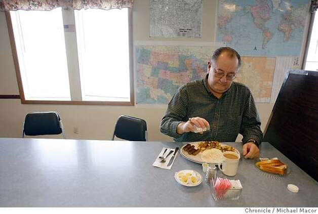"Medford resident Jim VanSant enjoys breakfast at ""Sally's Kitchen"" in downtown Medford. Jackson County in Southern Oregon, just across the Northern California border is going to close all 15 branch libraries on April 7 due to federal budget cuts. Photographed in, Medford, Or, on 2/23/07. Photo by: Michael Macor/ San Francisco Chronicle Photo: Michael Macor"