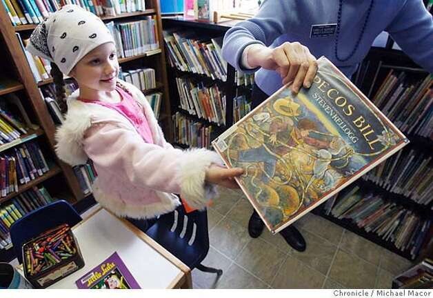 8 year old Rosamond Kimball of Phoenix, Or. gets help finding a book from Phoenix Branch Supervisor, Camille Korsmo. Phoenix Branch Library, temorary location while the permanent building is constructed downtown. Jackson County in Southern Oregon, just across the Northern California border is going to close all 15 branch libraries on April 6 due to federal budget cuts. Photographed in, Medford, Or, on 2/23/07. Photo by: Michael Macor/ San Francisco Chronicle Photo: Michael Macor