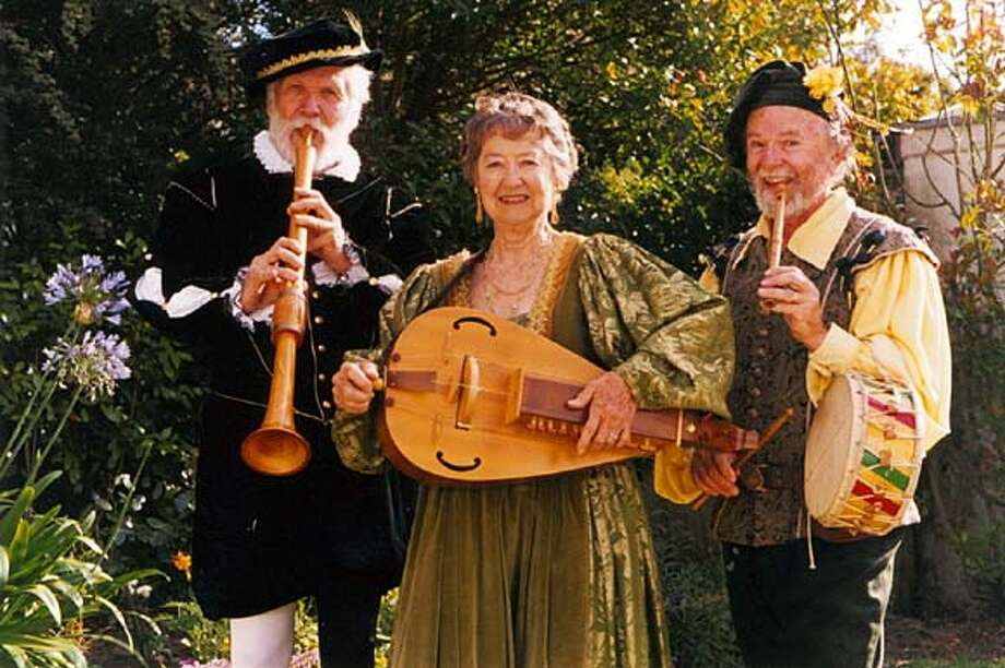 HIS MAJESTIE'S MUSICIANS  RALPH PRINCE WITH A SHAWM; LEE MCRAE WITH HURDY-GURDY, DICK BAGWELL WITH PIPE IN MOUTH AND TABOR ON HIS HIP.