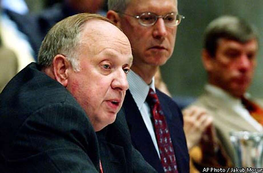 Linton , left, administrator of the National Nuclear Security Administration (NNSA) announces at the UC Regents meeting Thursday, May 15, 2003, in San Francisco, that the government has ended the University of California's 60-year control of the Los Alamos nuclear weapons lab. spoke to regents Thursday, assuring them the decision to go to competitive bidding was necessary because of the problems at Los Alamos but not as a repudiation of the university. (AP Photo/Jakub Mosur) Photo: JAKUB MOSUR