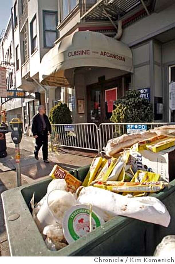 LANDSLIDE03_036_KK.JPG  On Friday afternoon a dumpster full of unused restaurant food sits on the sidewalk in front of the businesses that were declared unsafe for habitation by city officials after the Telegraph Hill landslide. Photo by Kim Komenich/The Chronicle �2007, San Francisco Chronicle/ Kim Komenich  MANDATORY CREDIT FOR PHOTOG AND SAN FRANCISCO CHRONICLE. NO SALES- MAGS OUT. Photo: Kim Komenich