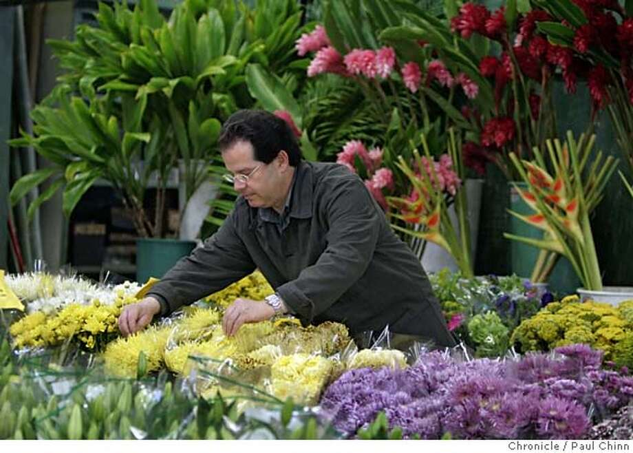 flowers19_063_pc.jpg  Gerald Prolman browses through an arrangement of flowers at Silver Terrace Nurseries at the Flower Market on 6/11/05 in San Francisco, Calif. Prolman runs Organic Bouquet, the first company trying to sell organic flowers nationwide through retailers like Silver Terrace.  PAUL CHINN/The Chronicle MANDATORY CREDIT FOR PHOTOG AND S.F. CHRONICLE/ - MAGS OUT Photo: PAUL CHINN