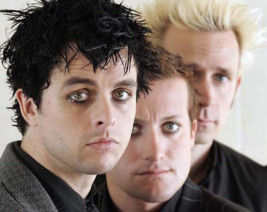 **FILE**Members of Green Day, Billie Joe Armstrong ,left, Tre Cool and Mike Dirnt ,right, pose for a photo between interviews in Toronto on Sept. 23, 2004.The group, Alicia Keys, Tim McGraw and U2 will perform at the 47th annual Grammy Awards next month. (AP Photo/CP,Adrian Wyld) Ran on: 02-13-2005  Usher: This could be his year at the Grammys. Photo: ADRIAN WYLD