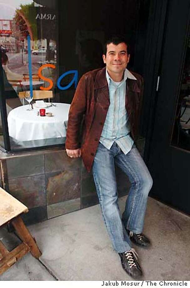 Chef Vernon Morales sits in front of one of his favorite restaurants, Isa, on Steiner.  Event on 8/9/05 in San Francisco. JAKUB MOSUR / The Chronicle Photo: JAKUB MOSUR