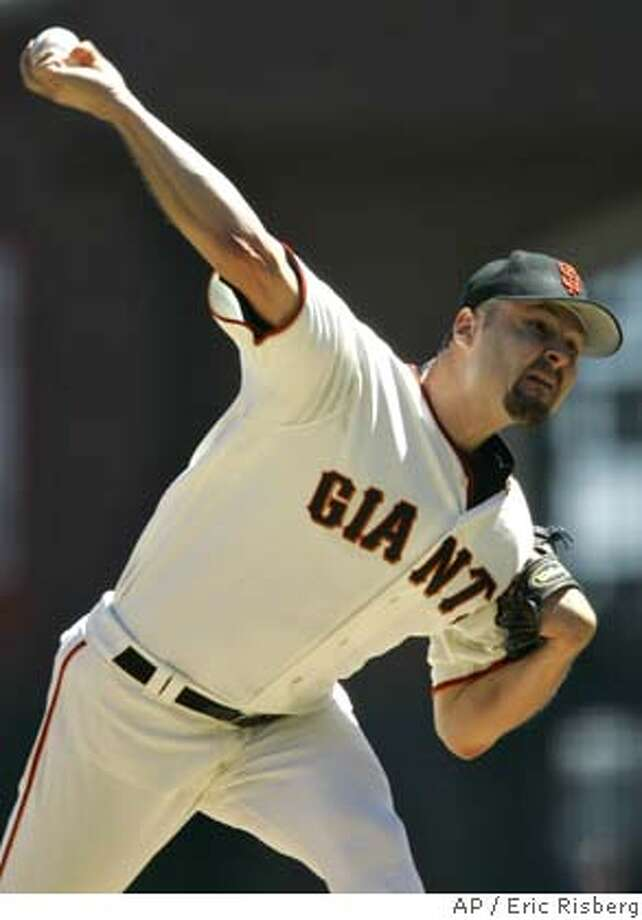 San Francisco Giants' starting pitcher Jason Schmidt throws against the New York Mets during the first inning of their game in San Francisco, Saturday, Aug. 27, 2005. (AP Photo/Eric Risberg) Photo: ERIC RISBERG