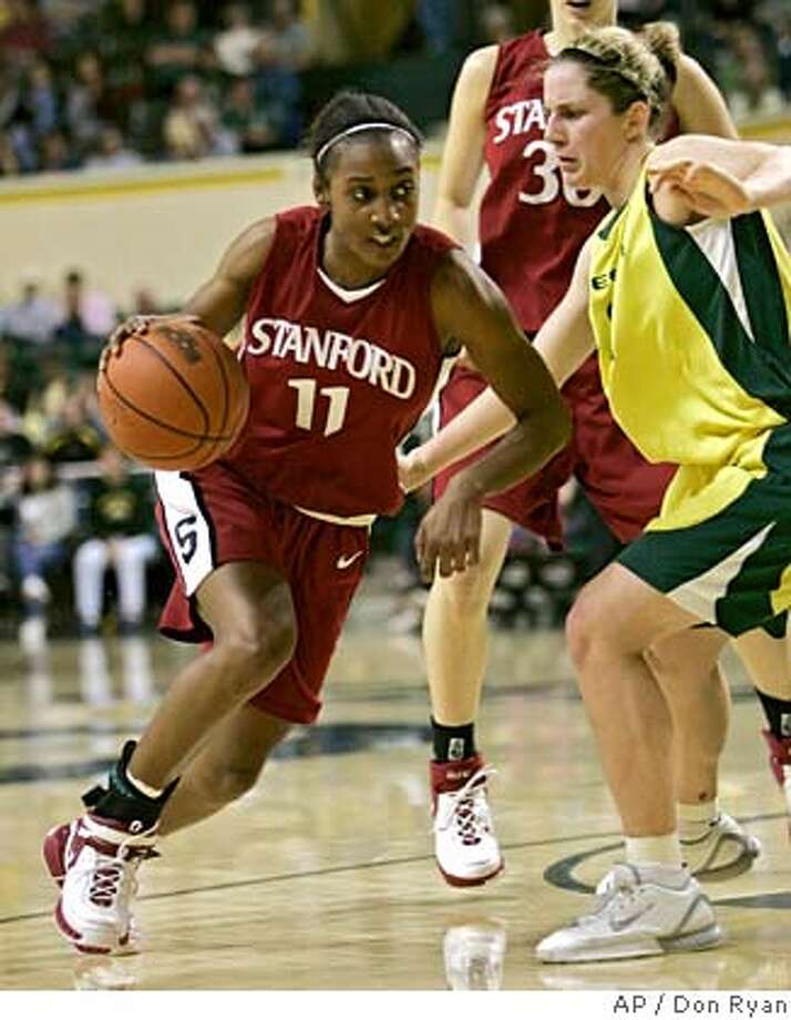 Stanford guard Candice Wiggins, left, drives to the hoop against Oregon guard Micaela Cocks during second half college basketball action in Eugene, Ore., Saturday, Feb. 17, 2007. Wiggins scored 17 points to help Stanford beat Oregon 734-56.(AP Photo/Don Ryan) Photo: Don Ryan