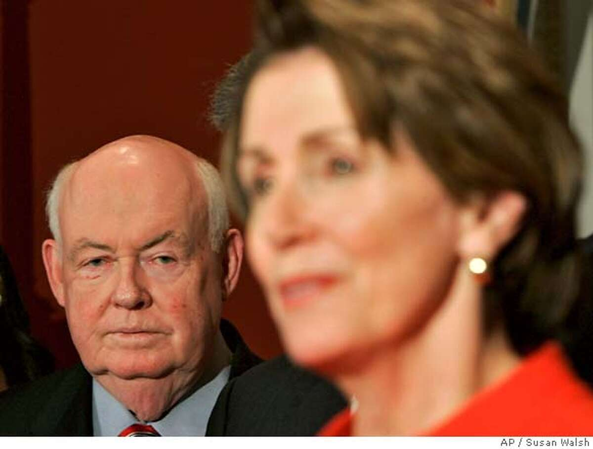 AFL-CIO President John Sweeney, left, looks over at House Speaker Nancy Pelosi of Calif., speaks during a news conference on Capitol Hill in Washington, Thursday, March 1, 2007 after the House passed a bill that would make it easier to start unions against companies' wishes. (AP Photo/Susan Walsh)