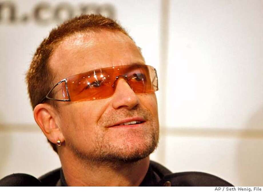 "** FILE ** Bono of the band U2 signs copies of the new book ""U2 by U2"" in this Sept. 26, 2006 file photo in New York. Britain confirmed Saturday Dec. 23, 2006 Bono will receive his honorary knighthood from the British ambassador to Ireland, David Reddaway, in a Dublin ceremony shortly after New Year's Day. The Dubliner, whose real name is Paul Hewson, won't be entitled to use the title ""Sir"" because he is not a British national. (AP Photo/Seth Wenig, File)  Ran on: 12-26-2006  Bono SEPT. 26, 2006 FILE PHOTO Photo: SETH WENIG"