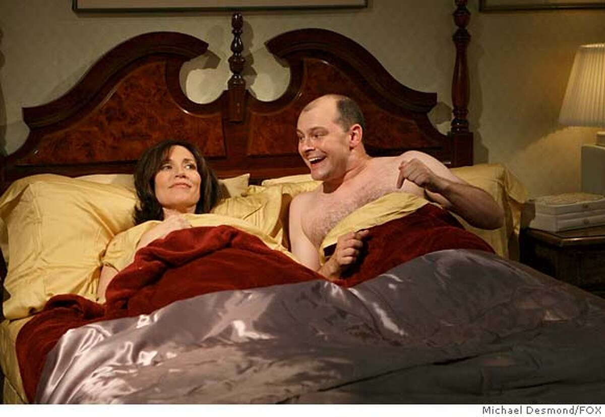 THE WINNER: Glen (Rob Corddry, R) is seduced by his former teacher (Katey Sagal, L) in the