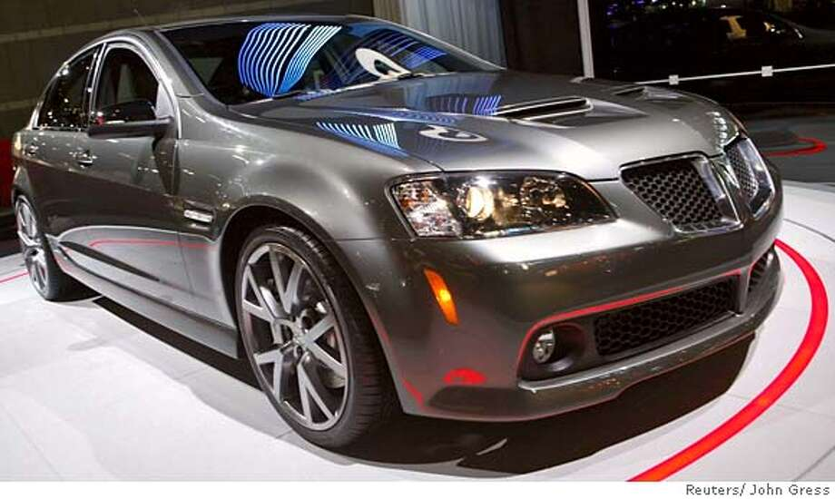 The 2008 Pontiac G8 after its debut at the Chicago Auto Show, February 8, 2007. REUTERS/John Gress (UNITED STATES) 0 Photo: JOHN GRESS