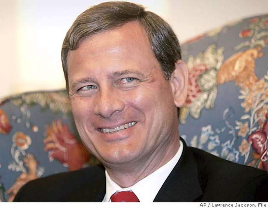 "** FILE ** Supreme Court nominee, John Roberts, flashes a smile while waiting to meet with Sen. Orrin Hatch, R-Utah, on Capitol Hill, July 21, 2005, in Washington. Roberts received a ""well qualified"" rating from the American Bar Association on Wednesday Aug. 17, 2005, clearing another hurdle in his path to the highest U.S. court. (AP Photo/Lawrence Jackson) Photo: LAWRENCE JACKSON"