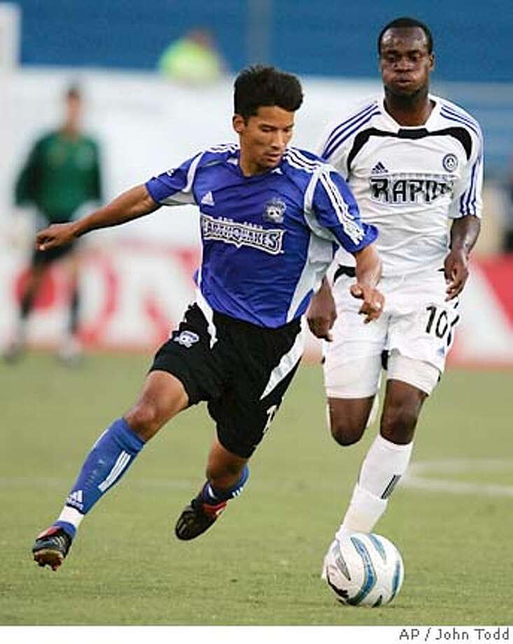 San Jose Earthquakes' Mark Chung dribbles in front of Colorado Rapids' Jean Phillippe Peguero, right, during the first half at Spartan Stadium in San Jose, Calif., Saturday, Aug. 13, 2005. (AP Photo/John Todd) Photo: JOHN TODD