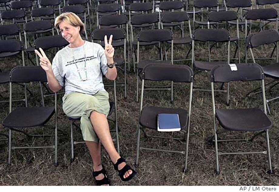 Cindy Sheehan makes peace signs sitting in the giant tent at her anti-war camp near President Bush's ranch in Crawford, Texas, Friday, Aug. 26, 2005. (AP Photo/LM Otero) Ran on: 08-27-2005  Cindy Sheehan remains at her anti-war camp near President Bush's ranch in Crawford, Texas, but the president took to the road. Ran on: 08-27-2005  Cindy Sheehan remains at her anti-war camp near President Bush's ranch in Crawford, Texas, but the president took to the road. Photo: LM OTERO