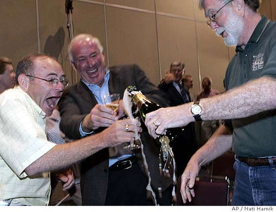 Sid Goss, left, Mike Derby and Bob DeMersseman, right, celebrate in Rapid City, S.D. it's for you Friday, Aug. 26, 2005, the Defense Base Closure and Realignment Commission's (BRAC) decision not to close Ellsworth Air base in South Dakota.(AP Photo/Nati Harnik) Ran on: 08-27-2005  Backers Sid Goss, Mike Derby and Bob DeMersseman (from left) in Rapid City, S.D., toast the decision to save Ellsworth Air Force Base. Photo: NATI HARNIK