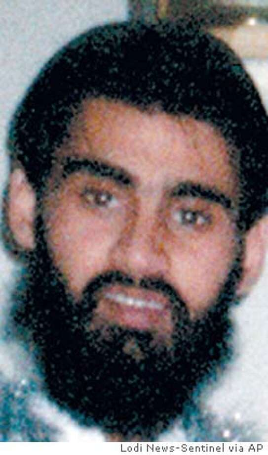 This is an undated photo of Hamid Hayat provided by the Hayat family. Hayat, 22, allegedly lied to agents when he denied attending a terrorism camp in Pakistan in 2003 and 2004. His father, Umer Hayat, 47, was charged with lying to investigators about his son's camp activity that he allegedly financed. U.S. District Judge Garland E. Burrell Jr. on Friday, July 1, 2005, set the trial for Aug. 23 and placed the burden on the government to prove why the two men should not be tried quickly. (AP Photo/Hayat family via Lodi News-Sentinel)