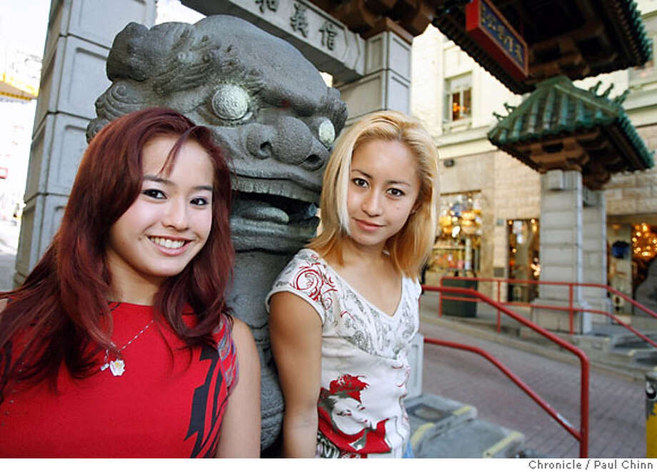 "Jennifer (left) and Cheri Haight visit Chinatown in San Francisco, Calif. on Tuesday, February 13, 2007. The sisters, who are cast members of Cirque du Soleil's ""KA"" show, will be star attractions at this year's Chinese New Year parade.  PAUL CHINN/The Chronicle  **Jennifer, Cheri Haight Photo: PAUL CHINN"
