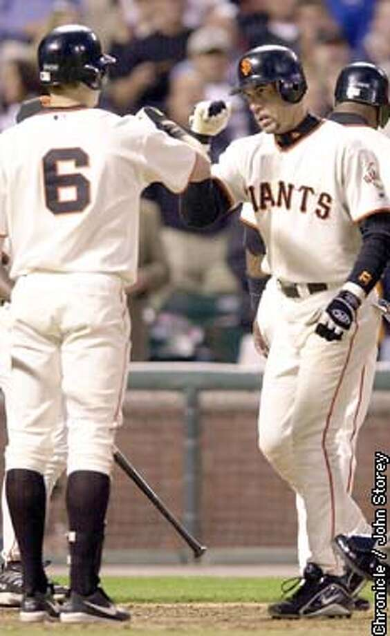 giants060_jrs.jpg  The Giants vs. the Arizona Dianmondbacks at Pac Bell Park. Benito Santiago of the Giants celebrates with J.T. Snow at home plate after his second home run. 5/28/03 in San Francisco. JOHN STOREY / The Chronicle Photo: JOHN STOREY