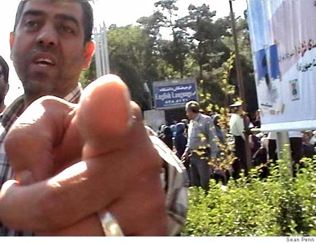 Sean Penn's video camera being taken from him at the women's demonstration at Tehran University. June 2005. Video still courtesy of Sean Penn.