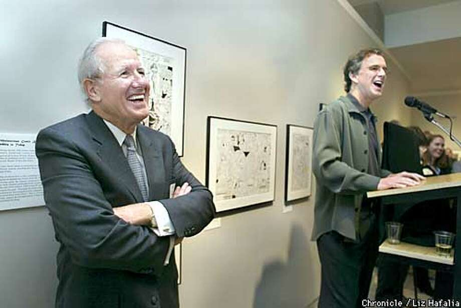 "Top cartoonists are gathering tomorrow in San Francisco for the 2003 Reuben awards presented by the National Cartoonists Society. Tonight is a gathering of cartoonists at the Cartoon Art Museum as an opening event. ""Doonesbury""'s Gary Trudeau donating a historic print. John McMeel (Trudeau's boss) at left. Shot on 5/22/03 in San Francisco. LIZ HAFALIA / The Chronicle Photo: LIZ HAFALIA"