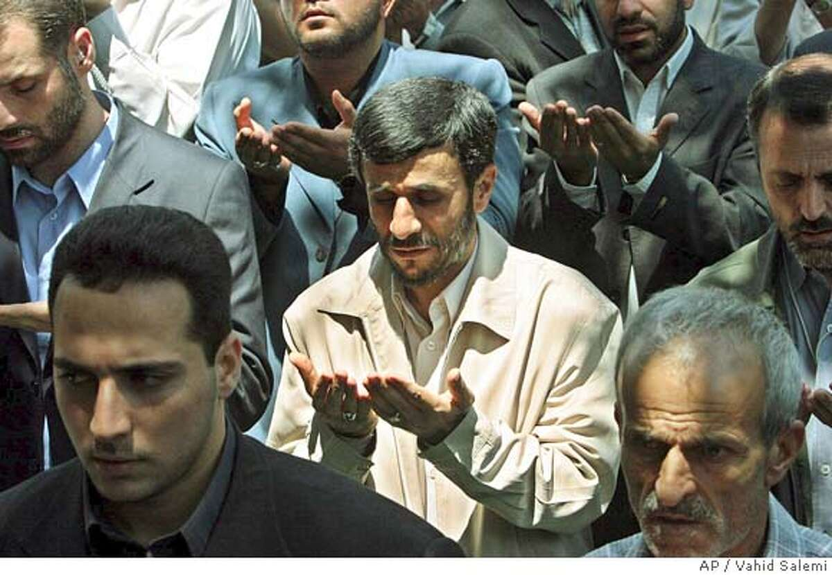 Iran's President-elect, Mahmoud Ahmadinejad, center, prays during Friday prayers, at the Tehran University campus, in Tehran, Iran, Friday, July 29, 2005. Ahmadinejad has said that his country will not pursue atomic weapons, but will also not submit to international pressure to abandon its nuclear program. (AP Photo/Vahid Salemi)