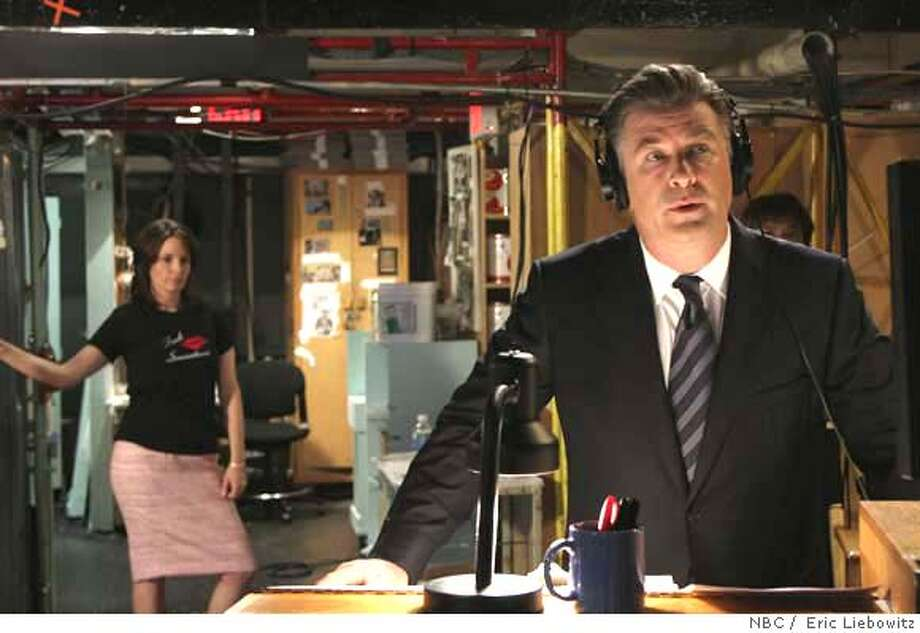 30 ROCK -- NBC Series -- Pictured: (l-r) Tina Fey as Lisa, Alec Baldwin as Jack -- NBC Photo: Eric Liebowitz Season:1 Photo: Eric Liebowitz