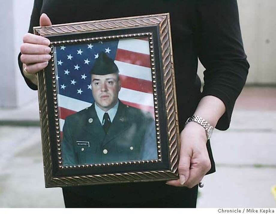 Nadia McCaffrey holds a picture taken of her son, Patrick McCaffrey just before he shipped off the Iraq. Patrick is one of 4 soldiers Tracy lost in the last 2 years.  We visit the town of Tracy, California on the two year anniversary of the Iraq War after is has been said they have statistically lost more more soldiers per capita that other towns.  Mike Kepka / The Chronicle Photo: Mike Kepka