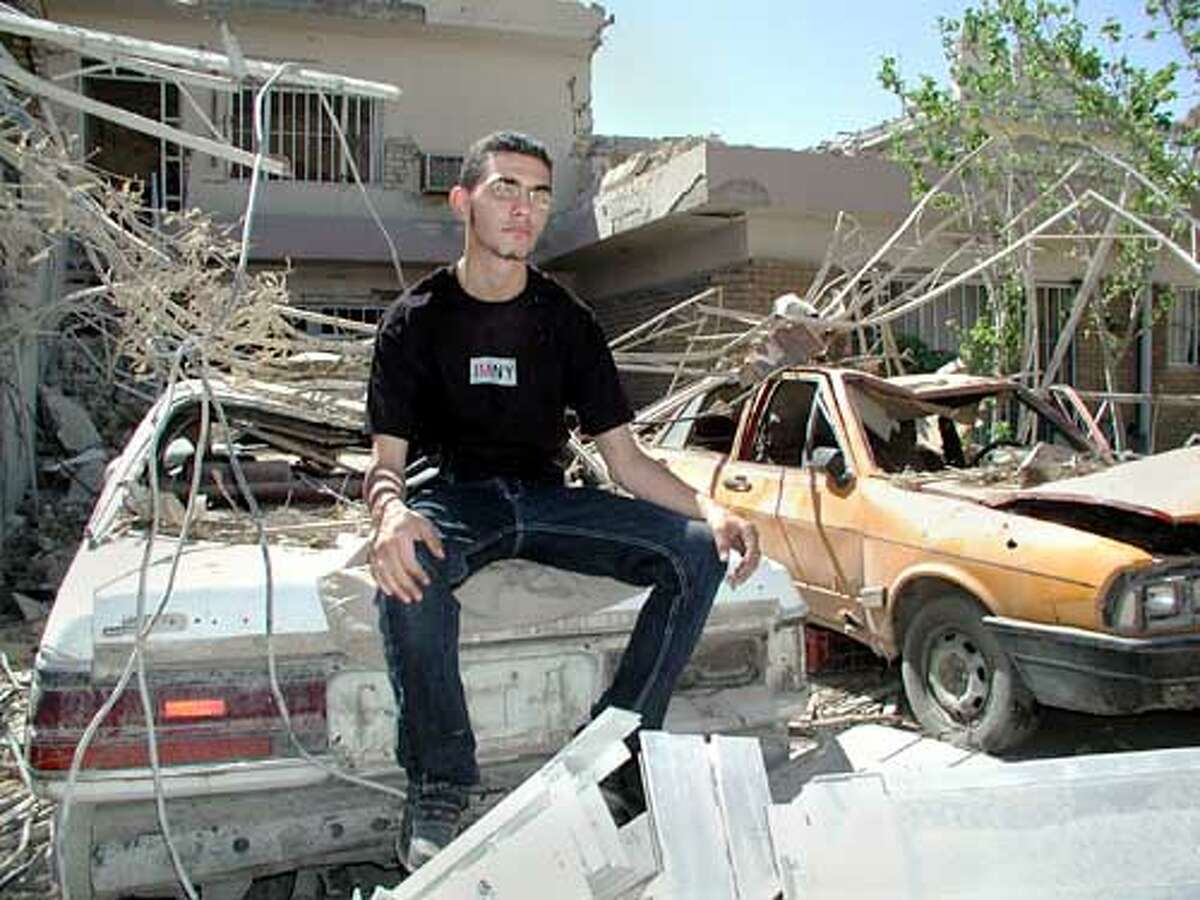 Waleed in bombed out#2609A.jpeg For SCORPION22; A.Crassicauda is Baghdad's only Death metal band. Pictured is lead singer, Waleed Moudhafar; 5/20/03 in . / HO