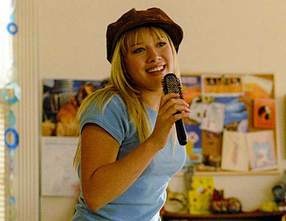 "Lizzie (Hilary Duff, pictured) can�t even sing alone in her room � how is she going to sing for millions in ""The Lizzie McGuire Movie"" on 4/8/03 in .  Rob McEwan / The Chronicle Photo: Rob McEwan"