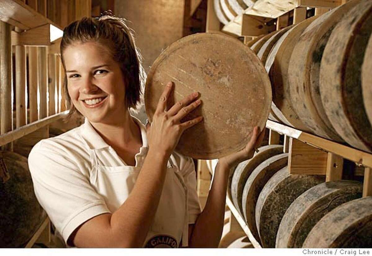 Photo of Marisa holding one of her Serena cheeses. Marisa Hilarides Simones is the 25-year-old cheesemaker for Three Sisters Farmstead Cheese in Lindsay, California. Her Serenita cheese just won a top prize at the annual American Cheese Society competition. Her cheese, Serena, also won a prize a few years back. Event on 8/3/05 in Lindsay. Craig Lee / The Chronicle