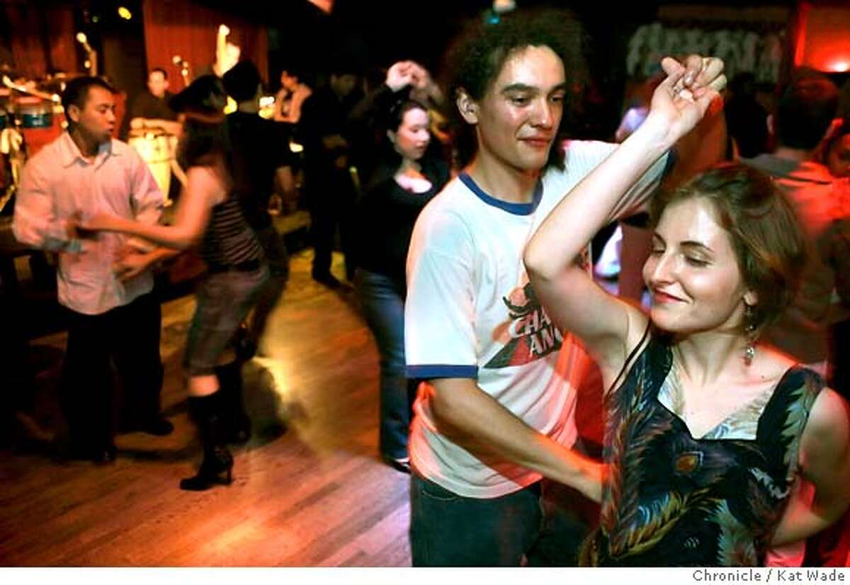 DOWNLOW_108_KW.jpg (RIGHT SIDE) L to R: Christopher Tafoya and Jessica Kirkpatrick dance to the live music of the band 'La Verdad' on Salsa night at the Shattuck Down Low Lounge in Berkeley on Wednesday February 21, 2007. Kat Wade/The Chronicle Christopher Tafoya and Jessica Kirkpatrick (CQ, subjects) Mandatory Credit for San Francisco Chronicle and photographer, Kat Wade, No Sales Mags out