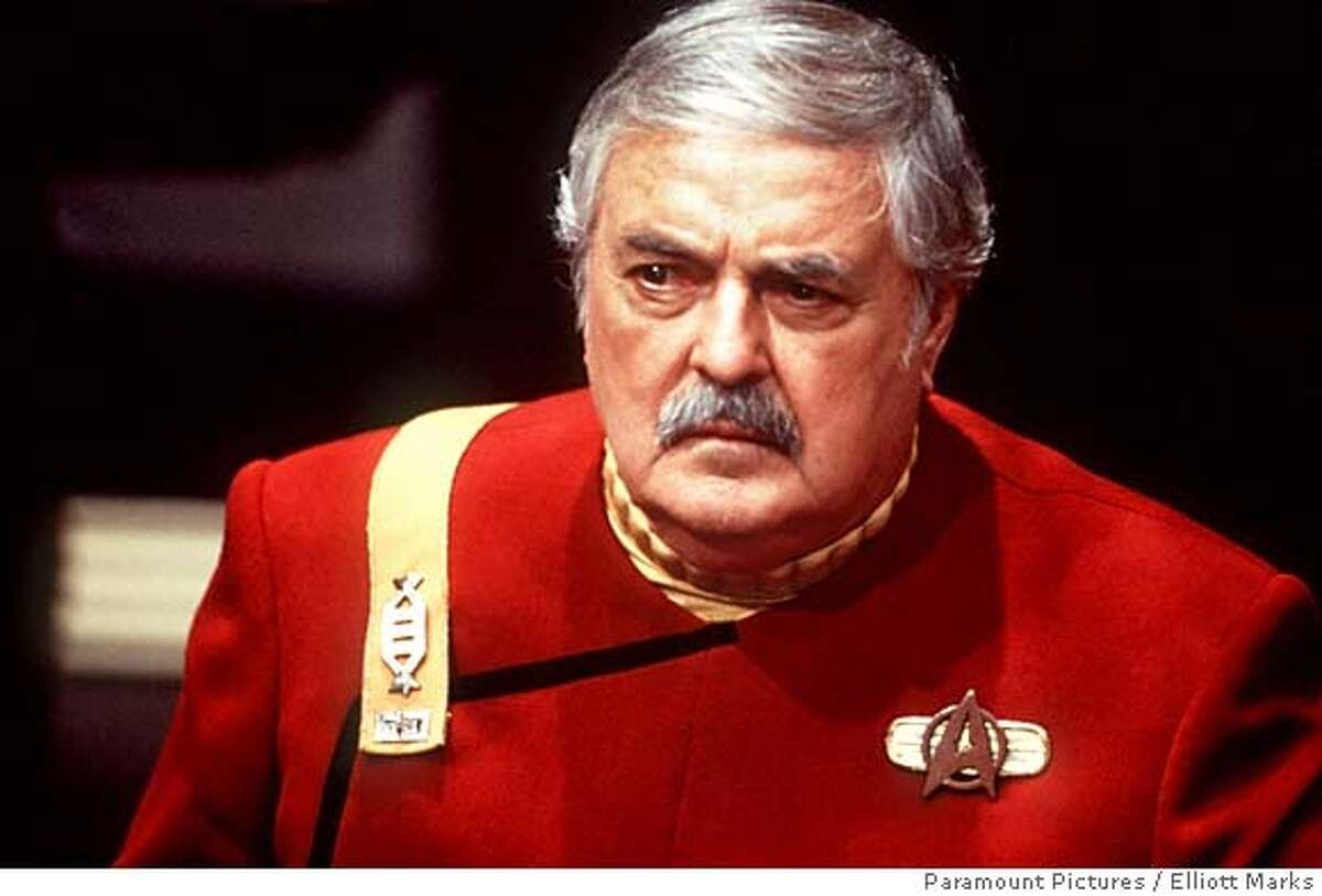 """In this undated publicity still provided by Paramount Pictures, Actor James Doohan appears in character as Montgomery """"Scotty"""" Scott in a scene from the 1994 film """"Star Trek Generations."""" Doohan, the burly chief engineer of the Starship Enterprise in the original """"Star Trek"""" TV series and movies who responded to the command """"Beam me up, Scotty,"""" died Wednesday, July 20, 2005. He was 85. (AP Photo/Paramount Pictures, Elliott Marks) Ran on: 07-21-2005 James Doohan played engineer Montgomery Scott in the popular TV series and movies. UNDATED PHOTO PROVIDED BY PARAMOUNT PICTURES"""