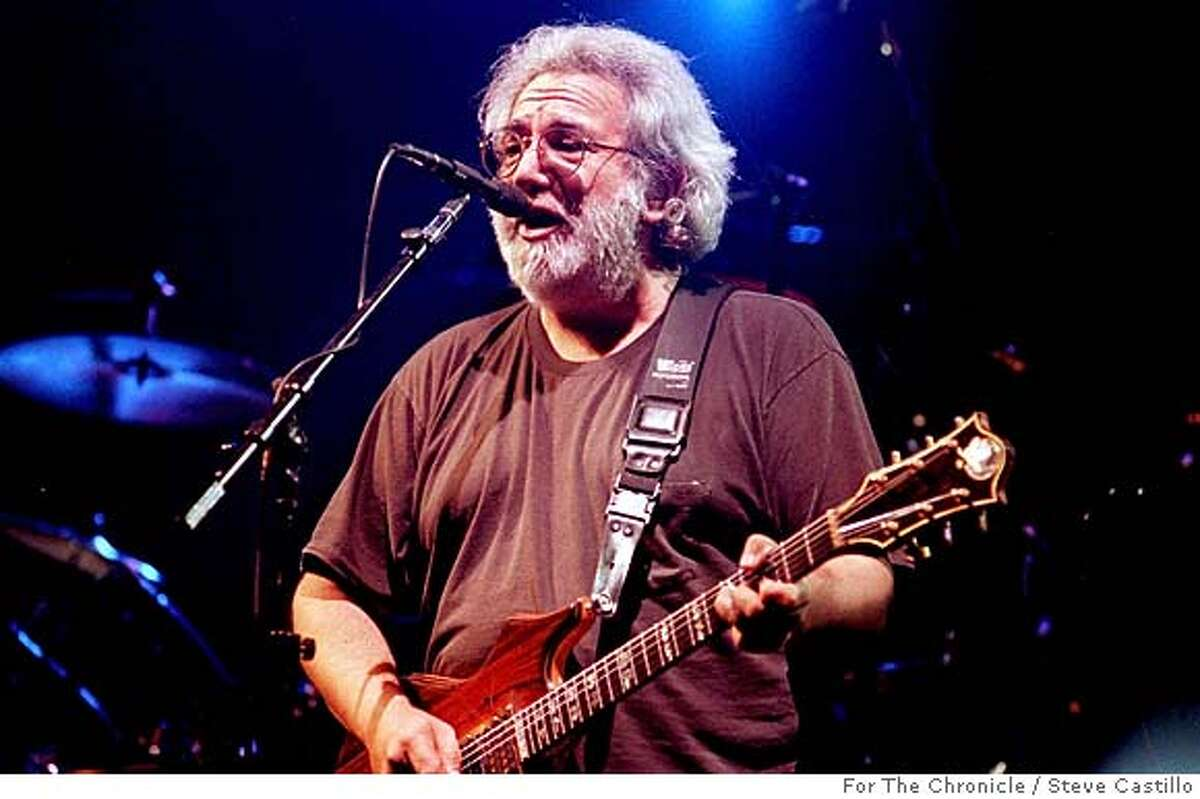 CONCERT/C/12DEC92/DD/SC - Photo by Steve Castillo for the San Francisco Chronicle. Jerry Garcia plays at a Grateful Dead concert at the Oakland Coliseum on December 12th, 1992. CAT