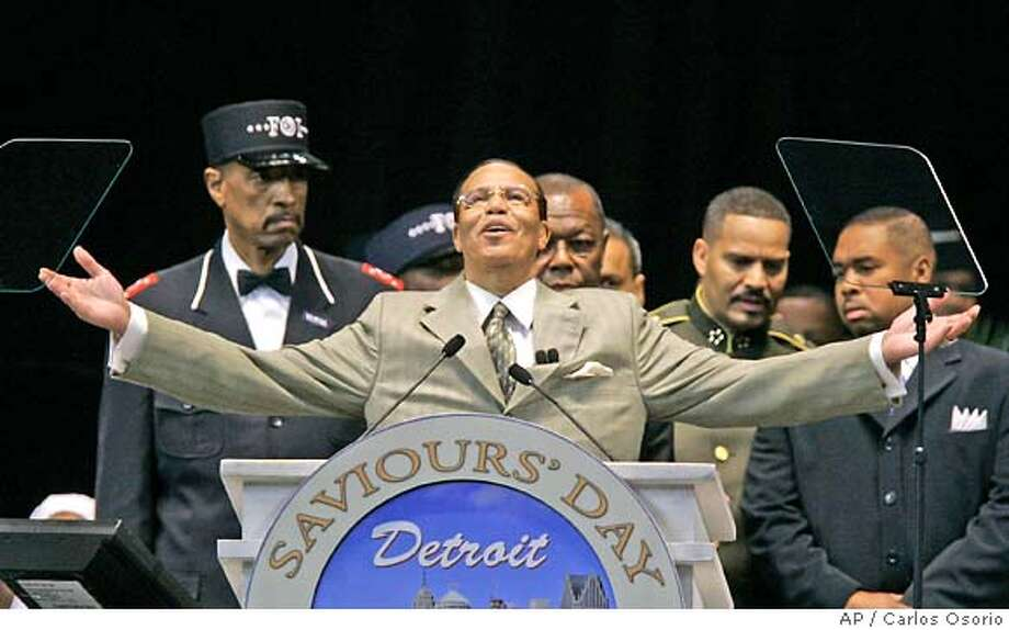 Nation of Islam leader Louis Farrakhan closes his address to the Saviours' Day gathering in Detroit, Sunday, Feb. 25, 2007. Farrakhan stressed religious unity Sunday during his final major speech, saying the world is at war because Christians, Muslims and people of other faiths are divided. The 73-year-old Farrakhan told the thousands at Detroit's Ford Field that Jesus Christ and the Prophet Muhammad would embrace each other with love if they were on the stage behind him. (AP Photo/Carlos Osorio) Photo: Carlos Osorio