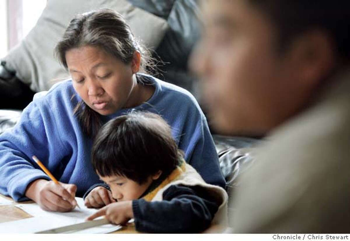�burma_597_cs.jpg Yan Aung (right) speaks with visitors as wife San San Win does spelling tests with son Nyein Chan, five-years-old, in their Oakland home. In 1988, Yan Aung was a student democracy advocate in Rangoon. When Burma's army massacred thousands of student-demonstrators that year, Yan Aung fled to the hills on Burma's
