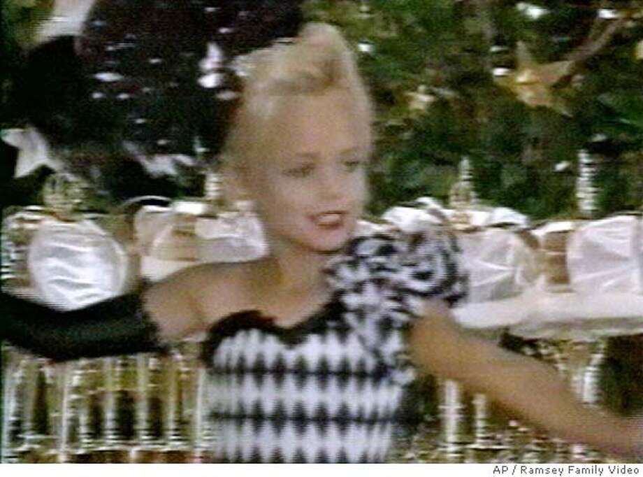 This image made from an undated family video shows JonBenet Ramsey performing during a beauty pageant. A former schoolteacher was arrested Wednesday, Aug. 16, 2006 in Thailand in the slaying of 6-year-old beauty queen Ramsey. Federal officials, speaking on condition of anonymity, identified the suspect as John Mark Karr, a 42-year-old American. (AP Photo/Ramsey family video)