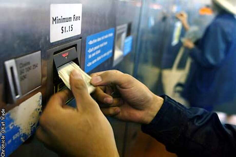 BART003_kw.JPG Hebert Bustamante feeds dollars into the fare machine at the North Berkeley BART station. KAT WADE / The Chronicle Photo: KAT WADE