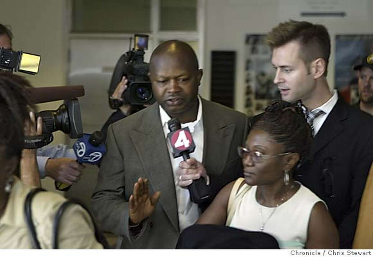 fallay0016.jpg Augustine Fallay, head of the Department of Building Inspection's one- stop permit program, is surrounded by friends or family following his release today, August 5, 2005, from the San Francisco Sheriff's Department, 425 Seventh Street. Fallay faces 10 counts of bribery and three counts of perjury resulting from an investigation by the Federal Bureau of Investigation and the San Francisco district attorney's office. Federal agents and district attorney's investigators descended on San Francisco's controversy-plagued building department Thursday and led away Fallay, a longtime city employee in handcuffs after arresting him on felony bribery charges. Chris Stewart / The Chronicle MANDATORY CREDIT FOR PHOTOG AND SF CHRONICLE/ -MAGS OUT