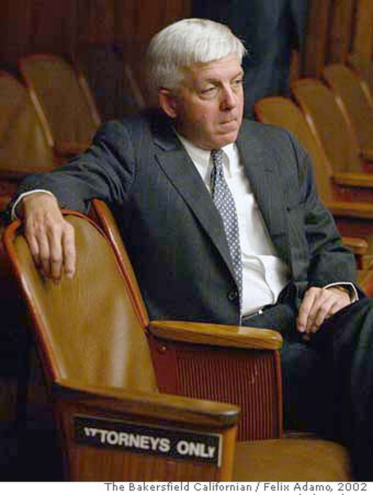 Kern County district attorney Ed Jagels sits in the front row of Superior court for the arraignment of Chris Hillis in the murder of Assistant District Attorney Stephen Tauzer. October, 2002. Photo by Felix Adamo / The Bakersfield Californian Pub date: 10/23/2002 News A2 pub date: 05/10/06 new a1