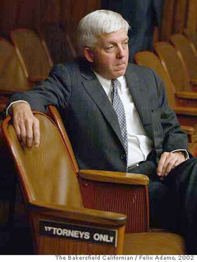 Kern County district attorney Ed Jagels sits in the front row of Superior court for the arraignment of Chris Hillis in the murder of Assistant District Attorney Stephen Tauzer. October, 2002. Photo by Felix Adamo / The Bakersfield Californian Pub date: 10/23/2002 News A2  pub date: 05/10/06 new a1 Photo: Felix Adamo