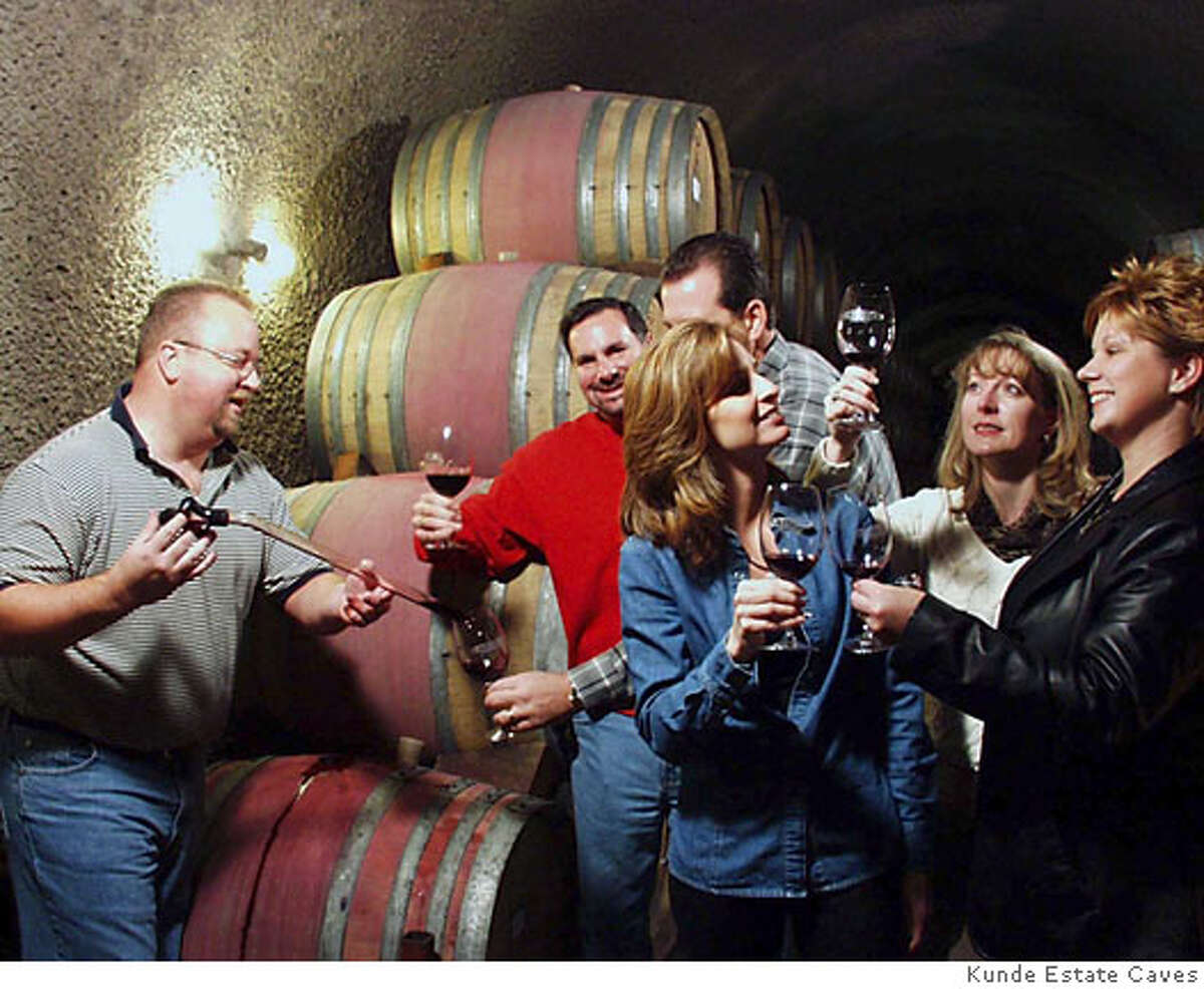 sat-sun.barrel20_PH.jpg / for: Datebook At the Kunde Estate Caves this is a photo for the weekend event Heart of Sonoma Barrel Tasting Weekend on Saturday and Sunday at 20 locations around Glen Ellen and Kenwood. The woman using the wine thief is a hospitality staff member at Kunde