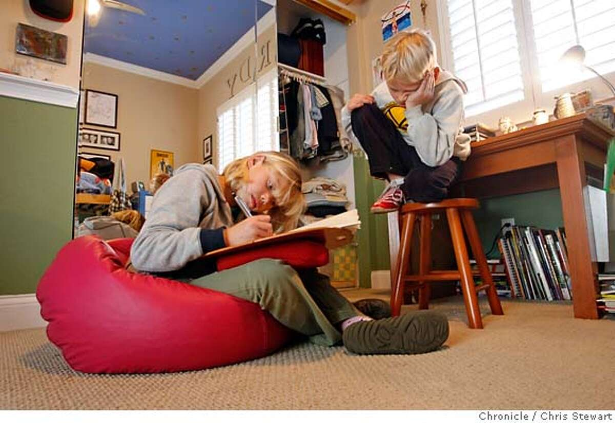 {filename .} Second grader Brady Scott, 7, watches sister and fourth grader Riley, 9, as she writes a story in a bean bag on the floor. Chris Stewart / The Chronicle Brady Scott, Riley Scott MANDATORY CREDIT FOR PHOTOG AND SF CHRONICLE/NO SALES-MAGS OUT
