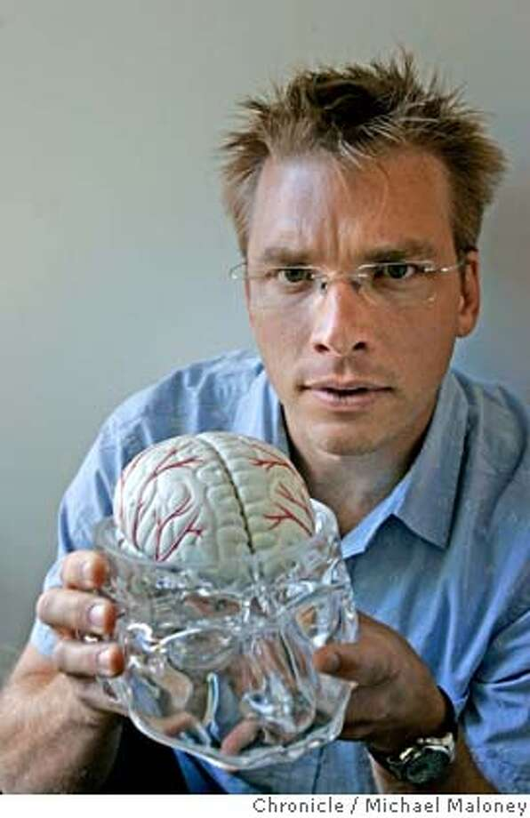 Peter Swearengen with a model of the human brain given to him by a friend.  Peter Swearengen, 39, is a filmmaker who made a documentary of his own brain surgery to correct epilepsy. He also works as a game-tester at Electronic Arts in Redwood City and has found that the stimulation has helped his recovery. Photo by Michael Maloney / San Francisco Chronicle Photo: Michael Maloney