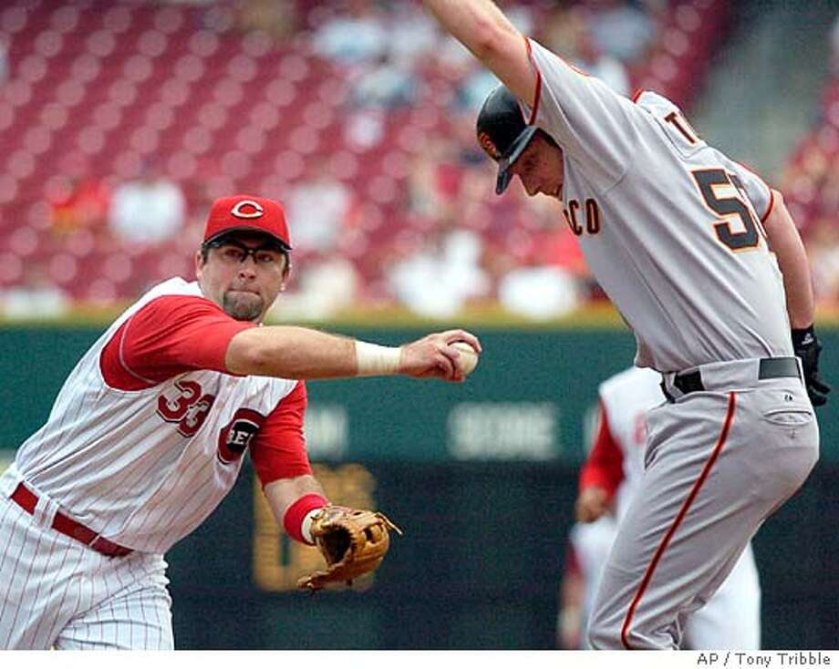 Cincinnati Reds Rich Aurilia tags San Francisco Giants Brett Tomko out before throwing to first base, getting batter Randy Winn out and completeing a double play in the third inning in Cincinnati Thursday Aug. 18, 2005. (AP Photo/Tony Tribble) Photo: TONY TRIBBLE