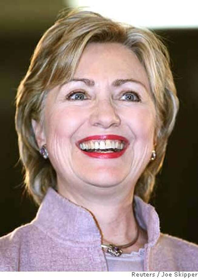"""U.S. Presidential candidate Senator Hillary Clinton (D-NY) smiles during a """"conversation with community leaders"""" presidential campaign event in Miami February 20, 2007. REUTERS/Joe Skipper (UNITED STATES) 0 Photo: JOE SKIPPER"""