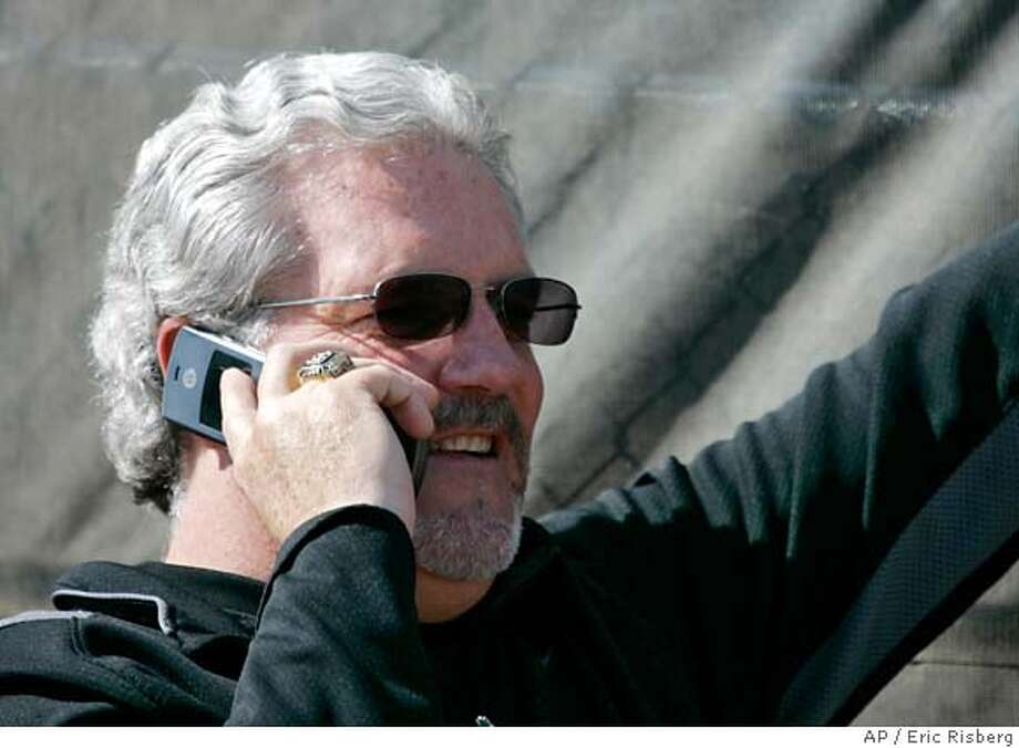 San Francisco Giants' general manager Brian Sabean talks on the phone while watching pitcher Barry Zito throw during a spring training baseball workout at Scottsdale Stadium in Scottsdale, Ariz., Thursday, Feb. 15, 2007. (AP Photo/Eric Risberg) Photo: Eric Risberg