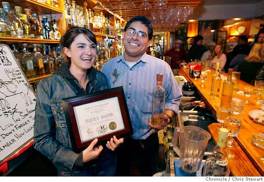 SPIRITS23_128_cs.jpg  New Blue Agave Club master Rebecca Doyle (cq), 27, of San Francisco with Julio Bermejo (cq) at Tommy�s Mexican Restaurant at 5929 Geary Blvd. in San Francisco. Bermejo of Tommy's is a tequila consultant and founder of Tommy's Blue Agave Club. He offers a program to educate drinker in the intricacies of tequila. Having sampled 35 different tequilas and passing a written test earns enthusiasts a diploma, a tee-shirt and membership in the club. Photographed February 19, 2007.  Chris Stewart / The Chronicle Tommy�s Mexican Restaurant, Julio Bermejo, Rebecca Doyle MANDATORY CREDIT FOR PHOTOG AND SF CHRONICLE/NO SALES-MAGS OUT Photo: Chris Stewart